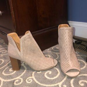 Open toed cream heels
